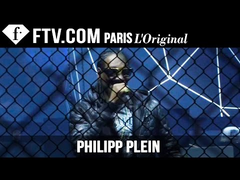 Fashion TV - http://www.FashionTV.com/live MILAN- Watch Philipp Plein's dramatic runway show. Rapper Snoop Dogg opens up the stage of a brooding runway with stomping drummers which make for a dark and...
