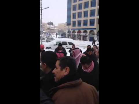 jordan's king helps residents in snowy streets