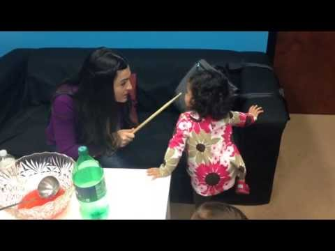 Mom Spanking her kid with a drum stick