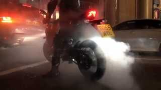 This Kawasaki Z800 with an Akrapovic exhaust system decided to do a couple of burnouts in the streets of Central London , which was cool!