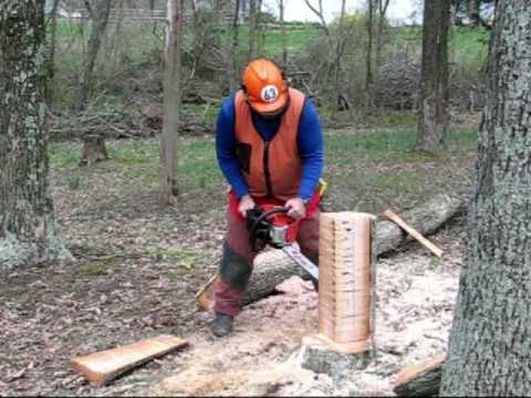 kickback - The instructor demonstrates a chainsaw kickback by directing it horizontally away from himself. Note that he uses only the tip of the saw, but that the saw k...