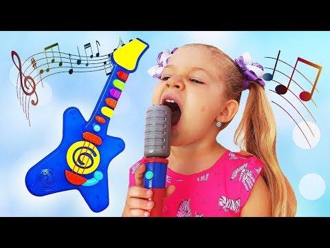 Videos musicales - Diana despierta a papá tocando instrumentos de musicales de juguetes