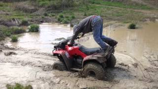 9. Honda recon 250 mudding