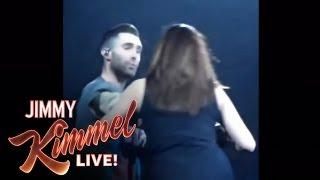 Adam Levine Accidentally Threw A Mic In A Fan's Face