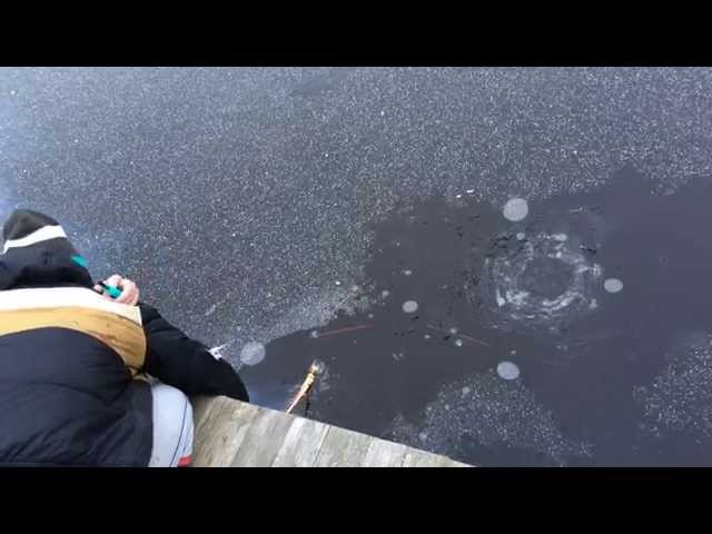 Guy Shoots Rocket Under The Ice Of Frozen Lake