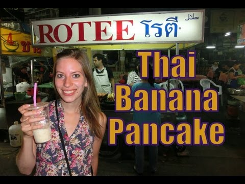 Eating a delicious Thai Banana pancake with chocolate for a snack