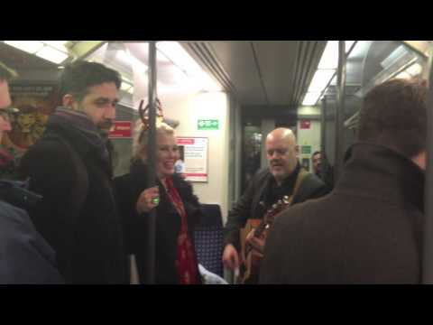 Wilde - Kim Wilde and Ricky Wilde serenade passengers on the train home after the MagicFM Christmas Party. After a truly rubbish day, I got on the train home and cou...
