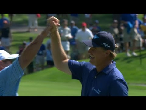 Golfer Ernie Els hits the ball directly into the cup from 160 yards away