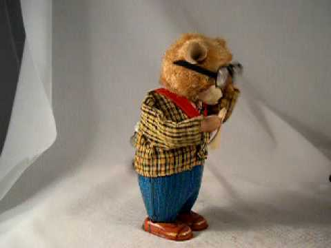 antique Toys 1950's - What a terrific old wind-up toy! The bear is made of tin, and when wound up he takes off his big spectacle glasses and wipes them clean with a cloth! Then he...