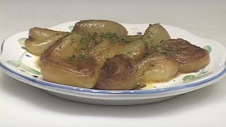 "This video demonstrates one good method for roasting half onions in the oven with a minimum of additional ingredients.  The fact that these onions are roasted with their skins still intact contains the shape and sugars that are released during the slow roasting process.  In some ways this is a good example of cooking a food item that relies on its natural flavors & textures to arrive at something that is outstanding.  These onions can be used for a variety of different food preparations such as salads, pastas, roasts, pizzas etc… and can be served hot, cold or room temperature.  This item is highly recommended for vegetarian and ""natural food"" approaches to cooking."