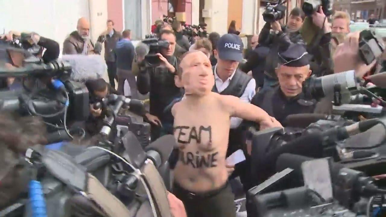 Γυμνόστηθες ακτιβίστριες FEMEN με μάσκες Πούτιν και Λεπέν
