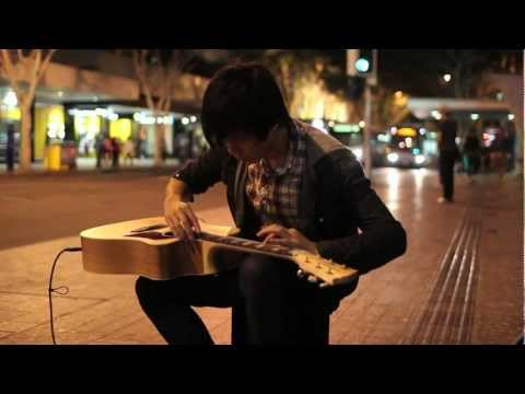 musician - I had never seen or heard anything like this before. An incredible musician playing his guitar on the corner of Adelaide and Albert Street, Brisbane. My gf ...