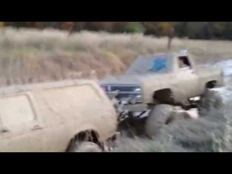 A Huge Lifted Chevy on 44 Boggers Pushing a stuck Ford Bronco!!!