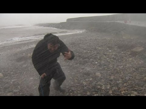Spray from a big wave hits BBC reporter - BBC News