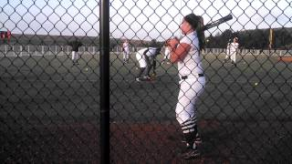 Sadie hurt ng weighted balls in warmups before a game. June 2013