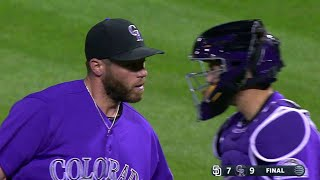 Greg Holland earns his 30th save and polishes off 9-7 win for the Rockies with three consecutive strikeouts in the 9th inning...