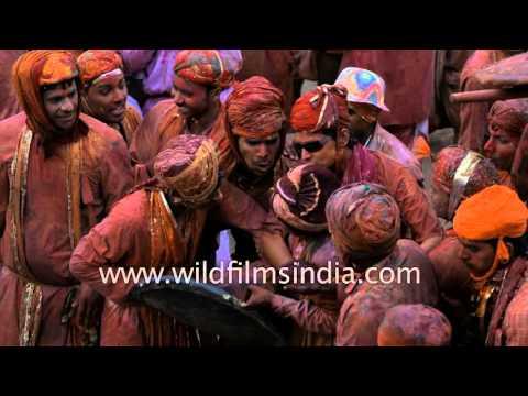 Lathmar holi festival of India where women beat their men!