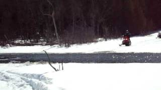 2. Joe crosses water on 2007 Polaris 600 switchback CFI
