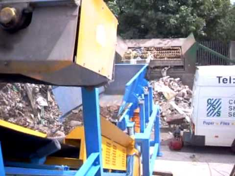 Recycled Building Waste Handled by Twin Motor Drive Feeder