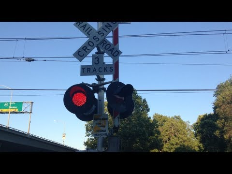 railroad crossing - I was in the downtown area again so I wanted to catch a light rail train or an Union Pacific Freight train here. This is the SACRT light rail Blue line next to the Union Pacific & BNSF Sacramento...