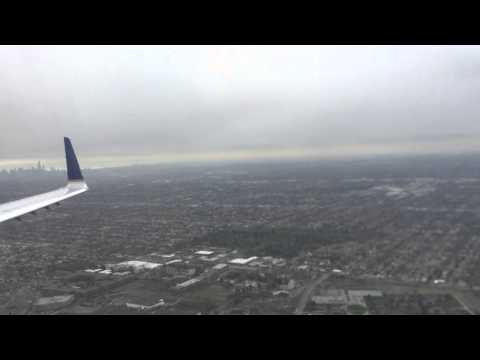 United Express ERJ-145 with Wingliets landing into ORD Chicago - snowy day