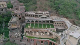 With the largely Japanese industrial township of Neemrana at its base, the fort-palace of Neemrana is the flagship property of the Neemrana Hotels group run by Aman Nath and Aude-priya Wacziarg.At the edge of an Aravalli range hill, the fort stacks up as you climb the hill, exposing layer after fabulous later of luxurious accommodations and ancient features turned into modern amenities.Neemrana lies on the National High way 8 or NH8, and is part of the busy industrial manufacturing corridor between Delhi and Jaipur in Rajasthan.This footage is part of the broadcast stock footage archive of Wilderness Films India Ltd., the largest collection of HD imagery from South Asia. The collection comprises of 150, 000+ hours of high quality broadcast imagery, mostly shot on 4K, 200 fps slow motion, Full HD, HDCAM 1080i High Definition, Alexa and XDCAM. Write to us for licensing this footage on a broadcast format, for use in your production! We are happy to be commissioned to film for you or else provide you with broadcast crewing and production solutions across South Asia. We pride ourselves in bringing the best of India and South Asia to the world... Please subscribe to our channel wildfilmsindia on Youtube  www.youtube.com/wildfilmsindia for a steady stream of videos from across India. Also, visit and enjoy your journey across India at www.clipahoy.com , India's first video-based social networking experience.Reach us at rupindang [at] gmail [dot] com and admin@wildfilmsindia.comTo SUBSCRIBE click the below link:www.youtube.com/subscription_center?add_user=WildFilmsIndiaLike & Follow Us on:Facebook: www.facebook.com/WildernessFilmsIndiaLimitedWebsite: www.wildfilmsindia.com