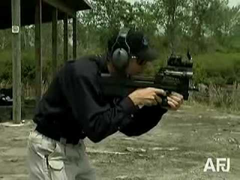 P90 - A demonstration of the Belgian FN P90 personal defense weapon, featuring a bull pup design, light recoil, and excellent handling.