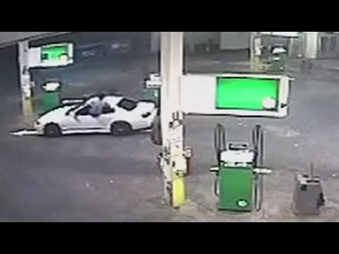 Man Ninja Jumps Through Open Car Window to Attack