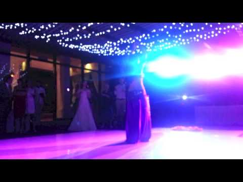 Lara belly dances at a wedding in Mexico