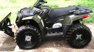 3. Like new 2009 Polaris Sportsman 400 with winch and plow