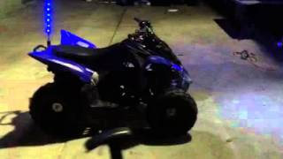 6. 2010 Yamaha raptor 90 with headlights and break light