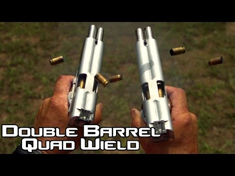 Slow motion footage of double barreled pistols firing bullets is