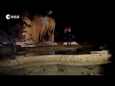 caves - Members of the CAVES 2013 crew talk about exploring inside the Sa Grutta cave - comparing their experience to arriving on the surface of a planet like Mars, ...