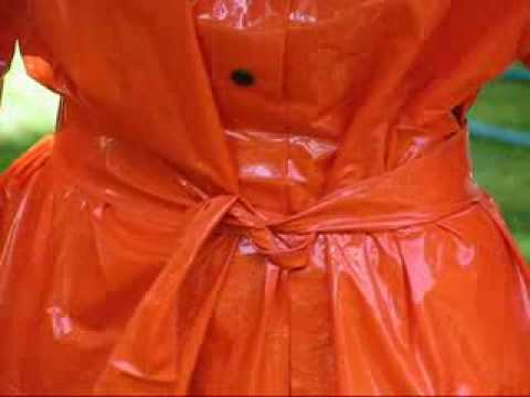 Rainweargirl - Secpnd part of the shiny orange PVC Raincoat.