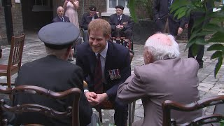 Prince Harry speaks to war veterans at Kensington Palace ahead of the premiere of Christopher Nolan's WWII film 'Dunkirk'.