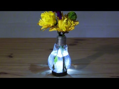 bulb - How to make a Light Bulb Vase. This DIY demonstration video shows how to empty out an old light bulb and make a cool home made vase, using a wire coat hanger...