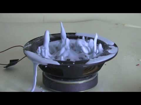 Speaker - Corn starch is a shear thickening non-Newtonian fluid meaning that it becomes more viscous when it is disturbed. When it's hit repeatedly by something like a...