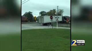 INSANE VIDEO: Train plows through straight through semi waptubes