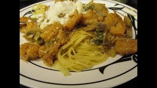 Creole style shrimp in a cream and wine sauce over pasta by Louisiana Cajun Recipes