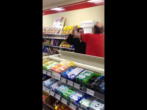 IN - Wasted girl freaking out at store clerks + Store clerk hitting her man in the head with a baton = Chaos in 7-11.