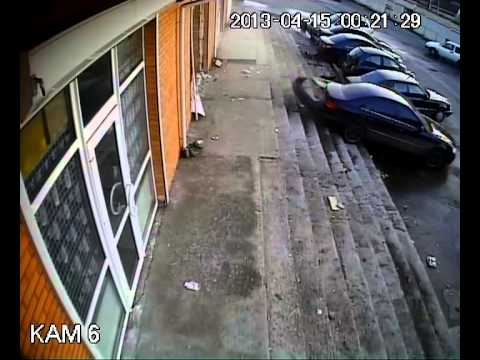 Security camera captures vehicle crashing through building in reverse