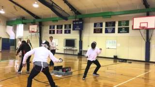 Isaac tries his hand at teaching his school mates Fencing.