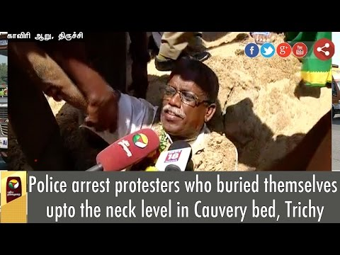 Police-pull-protesters-out-of-the-pit-where-they-buried-themselves-as-a-mark-of-protest