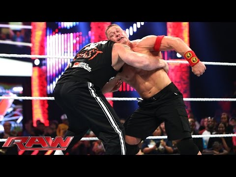 raw - John Cena and Brock Lesnar clash six days before their WWE World Heavyweight Championship Match Night of Champions.