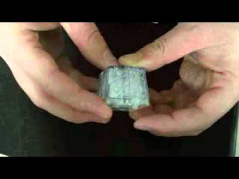 Key-press flashing Ice Cube with Removable Battery.