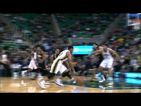 Trey Burke Gets to the Rack with the Crossover Between-the-Legs