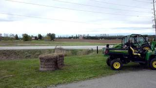 3. How to get a John Deere XUV 625i Gator to climb a haybale...backwards!
