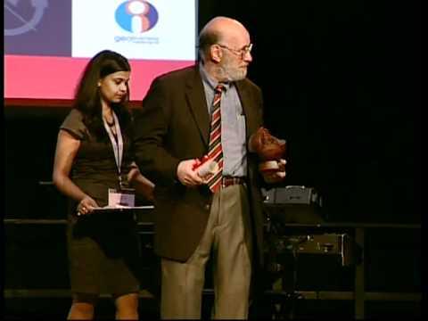 OGC's David Schell receiving Lifetime Achievement Award during Geospatial World Forum 2012