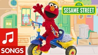 Sesame Street: Elmo Riding A Tricycle