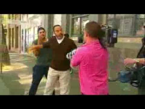 Cameraman pestering Muslim son and dad after repeatedly asked to leave them alone.